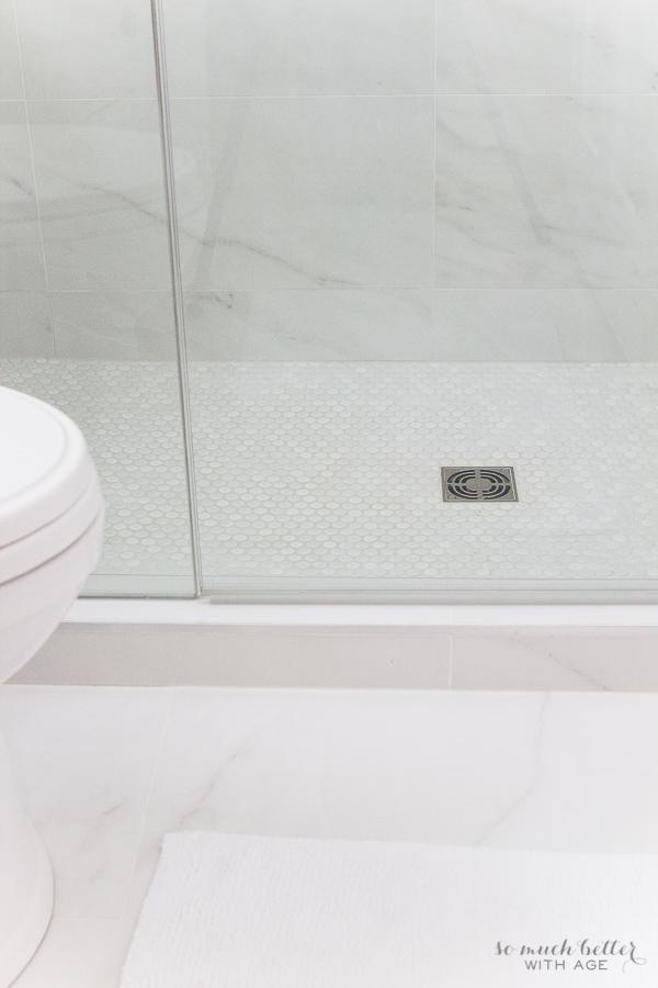 faux carrara marble master ensuite so