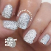 white and silver snowflake nails