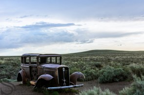 A 1932 Studebaker sits where Route 66 once cut through the Petrified National Forest, AZ
