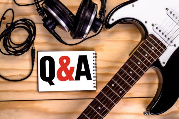 Q&A in a book with a guitar and headphones