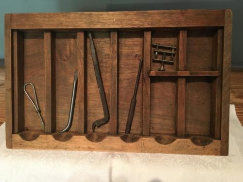 small wood case with tools