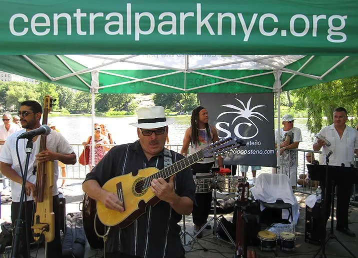 Juan Ma playing the cuatro at Central Park Meers, NYC