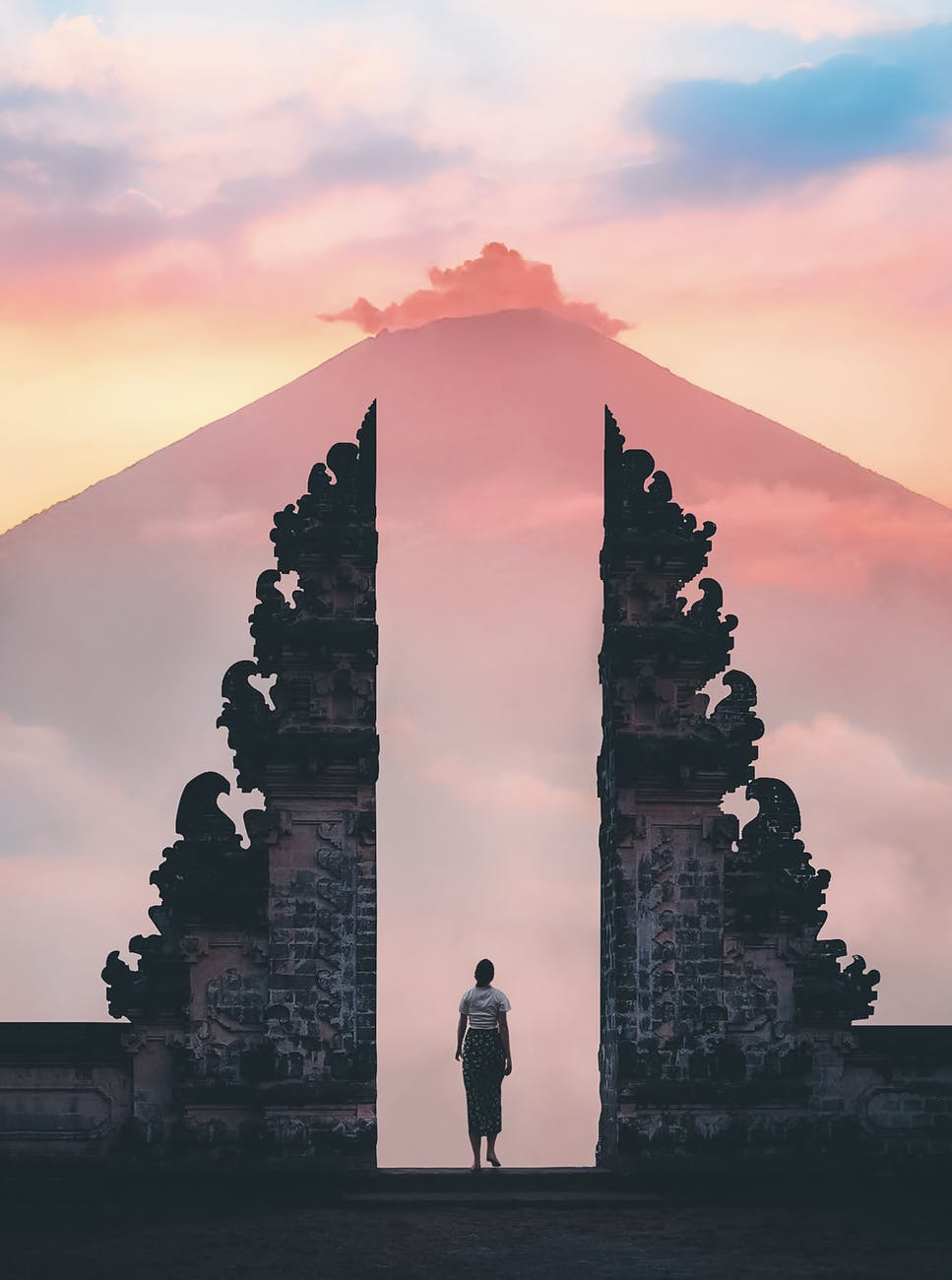 photo of person standing on a famous temple