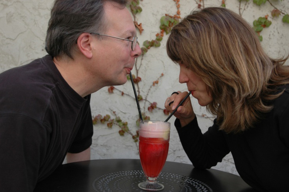 Ron and Carrie sharing a soda