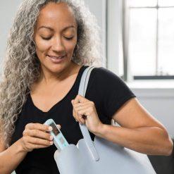 A-woman-with-EKGraph-Portable-ECG-Machine