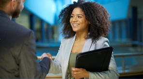 Confident woman shaking hands with potential employer