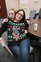 Celebrating with friends in silly sweaters