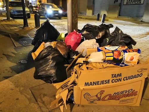 Si llueve, no saques tu basura.