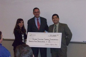 BC President Sonya Christian and BC Delano Director Richard McCrow accept a check from SCE Region Manager Cal Rossi