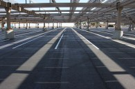 Newly repaved student parking under the solar panels