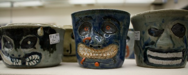 Series of mugs with scary faces.