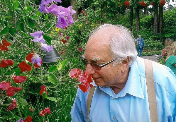 Bill Kelly smelling flowers