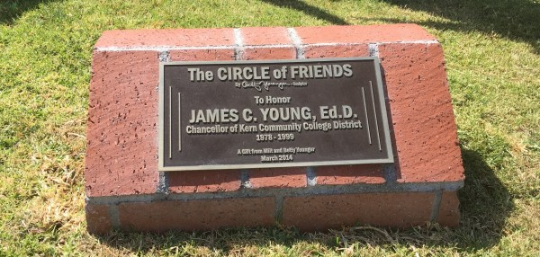The Circle of Friends by Betty Younger - sculptor.to Honor James C. Young, Ed.D. Chancellor of Ker Community College District 1978-1999 A gift from Milt and Betty Younger March 2014 plaque in front of sculpture.