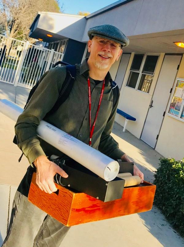 Nick Strobel holding box