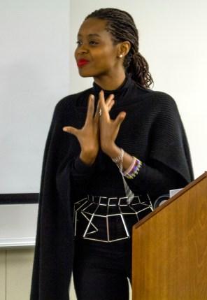 Clementine Wamariya speaks emotionally with hand gesture.