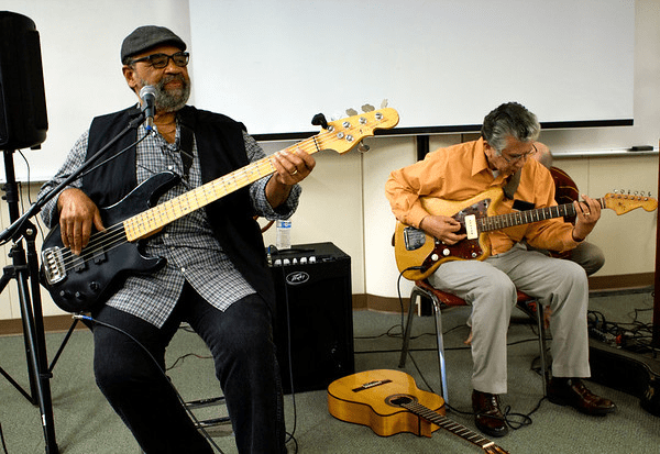 Billy Haynes from the Original Souls and Johnny Gomez from the Paradons perform in the Levan Center.