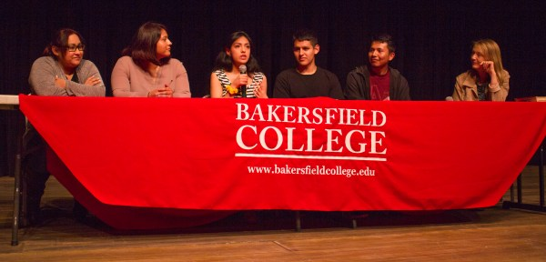 The Dreamer panelists and director sit at an onstage table with Bakersfield College cloth.