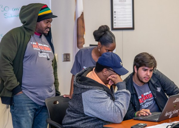 Students looking at laptop computer