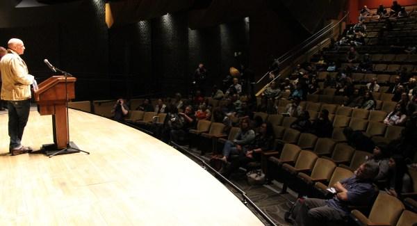 Eric Schlosser speaking on stage