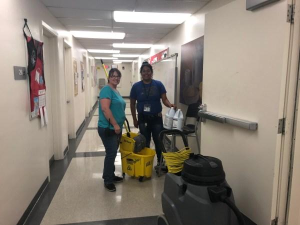 2 women in the hallway.