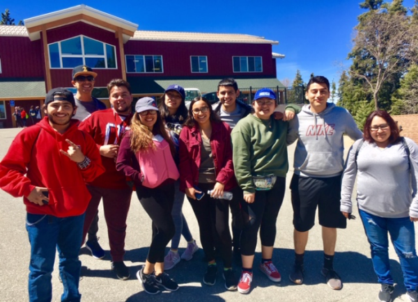 Group standing in front of a lodge.