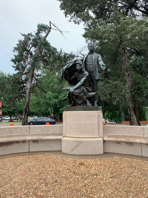 Statue of Washington assisting a slave.