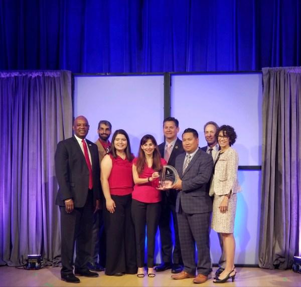 Group of BC and KCCD representative around the award.