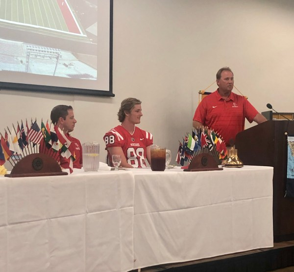 Coach Chudy speaking at podium.
