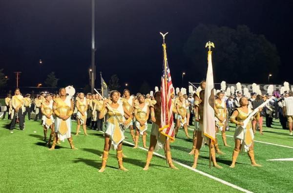 Flag bearers and band.