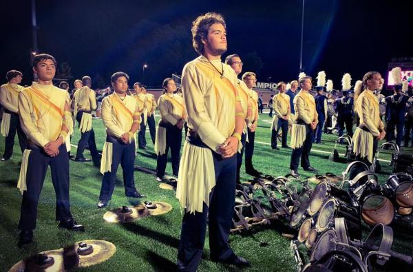 Drum corp at attention on field.