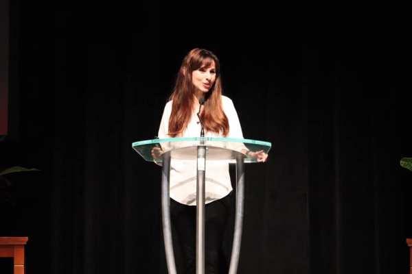 Sonya speaking from podium.