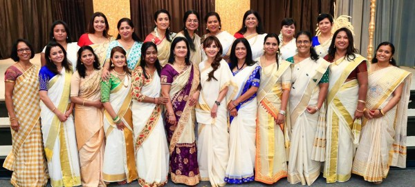 Sonya poses with 20 Onam participants.