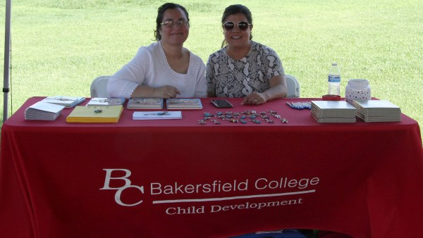 BC Child Development staff sitting at table