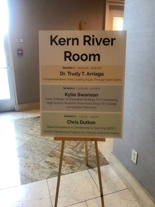 The Kern River Room sign with Kylie Swanson for Session 2.