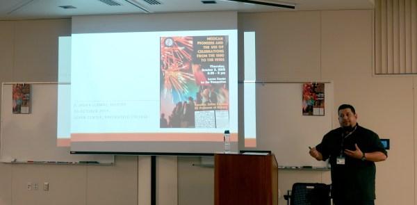 Llamas introducing his slide.