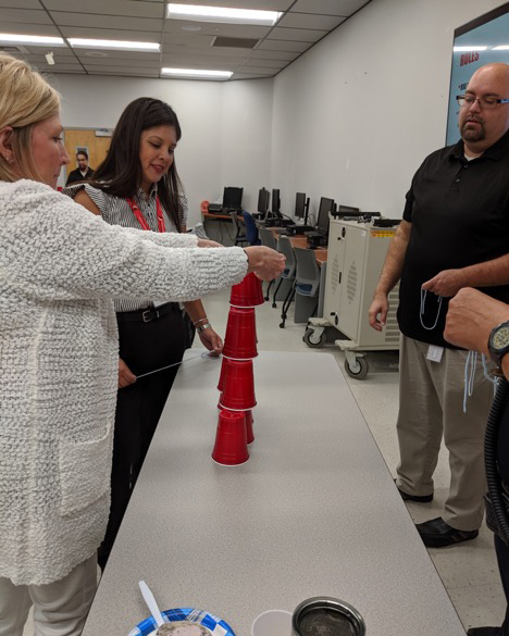 New BC employees stacking cups