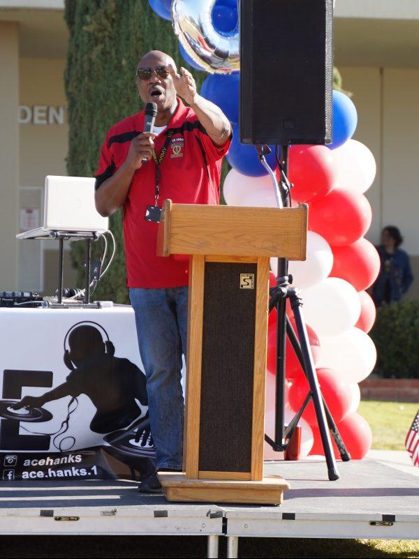Speaking on stage.
