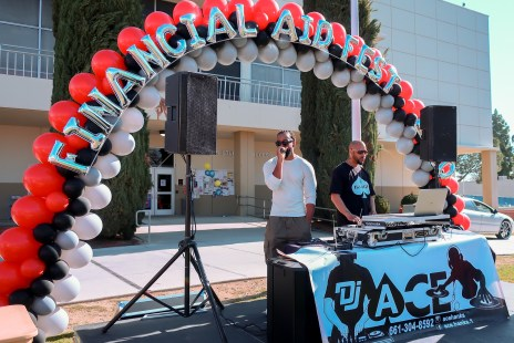 Danny Morrison and DJ Ace hold play music for Financial Aid Fest.