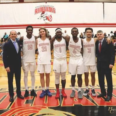 Coach Hughes with the men's basketball team.