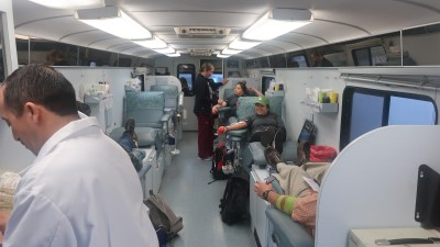 Inside of bus with chairs for donors.