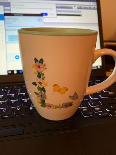 Flowers in an L with butterflies coffee cup.