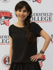 President Sonya Christian in front of a Bakersfield College wall.