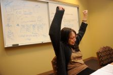 "Me celebrating during an Ashland U residency when a student connected all the dots. Behind me is one of the ""whiteboardings"" my students are sometimes subjected to."