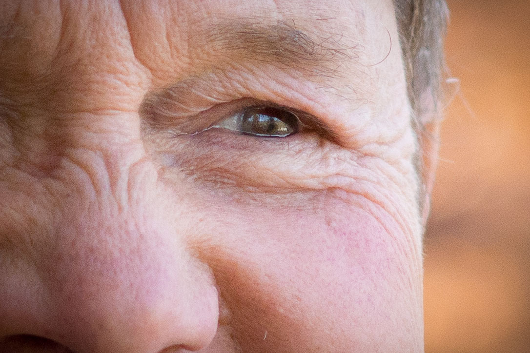 Sony Alpha 77 w/ 85mm f/1.4 - 100% Crop - My Dad in natural Light