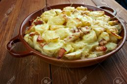 Tartiflette - French dish from the Savoie and Haute Savoie region. made with potatoes, reblochon cheese, lardons and onions.