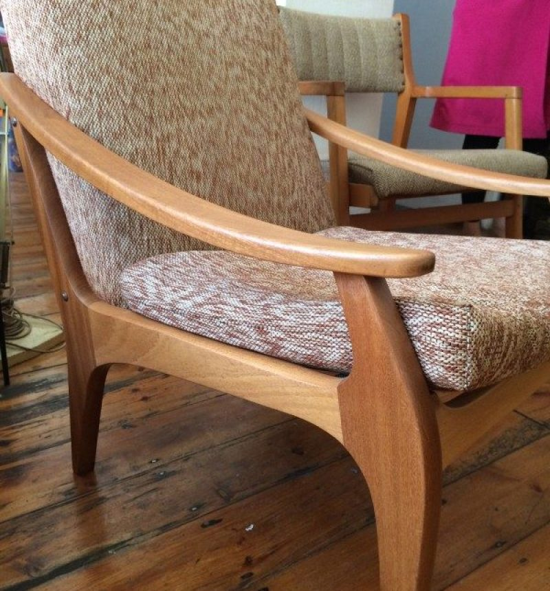 curved armrest and wooden legs