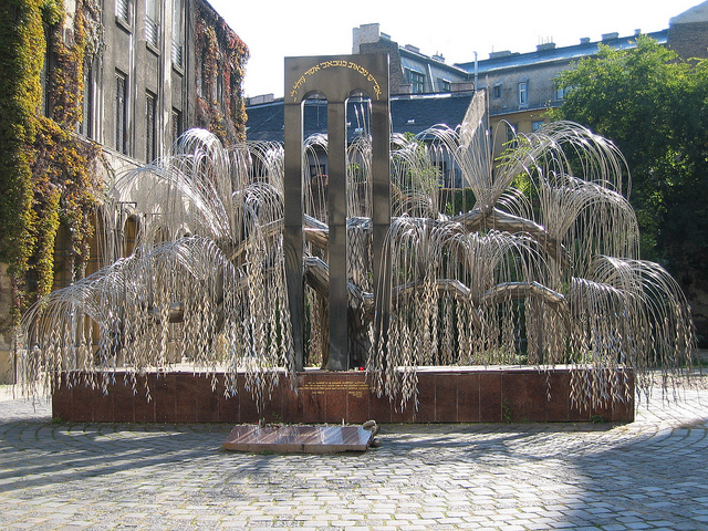 Holocaust memorial in Raoul Wallenberg Memorial Garden in Budapest, Hungary. Each leaf bears the name of a family killed by the Nazis. Photo by NH53 / CC BY