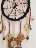 Detail: crocheted tails and wooden pendants