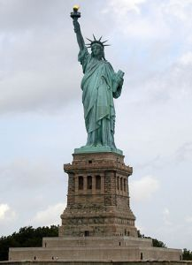 The Statue of Liberty, in New York Harbor, U.S. (Photo Wiki-Commons, by Elcobbola. Creative Commons Usage License.)