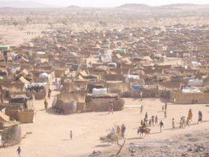 Darfur Refugee Camp in Chad, 2005, by Mark Knobil. PD-CCA via Wikimedia.